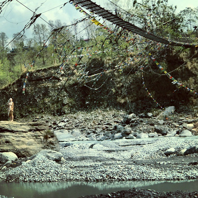 The sound of the flowing turquoise river, squeaking hanging bridge, the mumbling locals walking across it, waving prayer flags, the wind blowing through my hair...The capture does not honor the moment. #Nepal